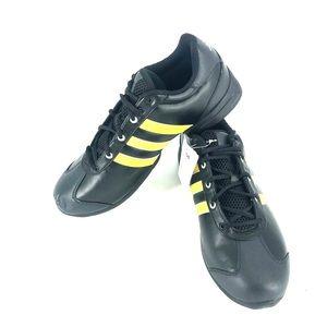 Adidas black yellow American football shoe.